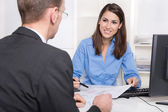 Business meeting - customer and adviser at desk. — Stock Photo