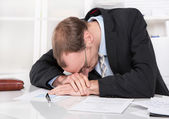 Frustrated manager with crisis sleeping at desk. — Stock Photo
