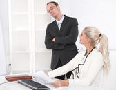 Bullying: boss controlling his secretary. — Stock Photo