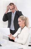 Deficit - negative sales revenues - shocked manager — Stock Photo