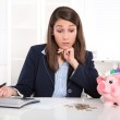 Pretty caucasian businesswoman in depression with piggy bank. — Stock Photo #36236043