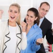Happy business team - young man and woman work colleagues. — Foto de Stock