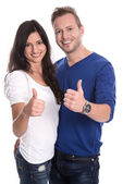 Young happy couple in love with thumbs up — Stock Photo