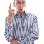 Man amazed finger raised — Stock Photo #36241701