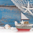 Toy boat with shells — Stock Photo