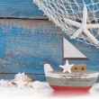Toy boat with shells — Stock Photo #36244883