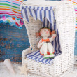 Figurine in doll furniture — Stock Photo