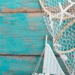 Sailboat with shells and fishing net — Stock Photo #36247767