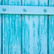Painted wooden gate in turquoise — Stock Photo
