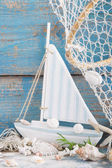 Sailboat with shells — Stock Photo