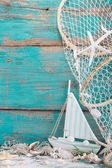 Sailboat with shells and fishing net — Stock Photo