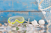 Diving mask with starfish and shells — Stock Photo