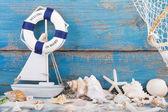 Toy sailboat and life buoy — Stock Photo
