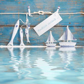 Fishes hanging from rope, boats — Stock Photo