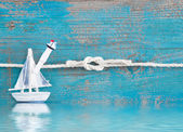 Sailboat pinned to rope — Stockfoto