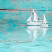 Toy sailboats on water — Stock Photo