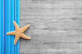 Starfish on wooden background — Stock Photo