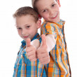 Stock Photo: Little boys - brothers - isolated with thumbs up.