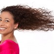 Windy: laughing woman with blowing hair in wind isolated on whit — Stockfoto