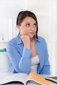 Disappointed, sad and overworked young woman at desk. — Stockfoto