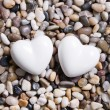 Stock Photo: Two white hearts for a wedding greeting card.