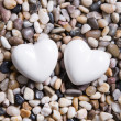 Two white hearts for a wedding greeting card. — Stock Photo