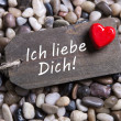 I love you card with german text and a red heart on a wooden sig — Foto de Stock