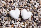 Two white hearts for a wedding greeting card. — Stockfoto
