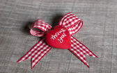 """Red heart with """"thank you"""" for a greeting card on checked ribbon — Stock Photo"""