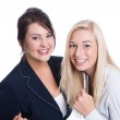 Success: two satisfied business women smiling in business outfit — Foto de Stock
