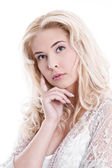 Portrait of young pretty blond woman thinking on white background. — Stock Photo