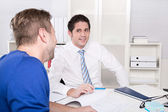 Image of two young businessmen at meeting — Stockfoto
