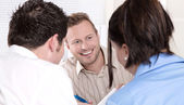 Consultant with a couple at office. — Stock Photo