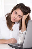 Tired young business woman in bright Office. — Stock Photo