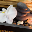 Candle and spa stones — Stock Photo