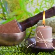 Stock Photo: Singing bowl and candle
