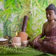 Buddha figurine with bath salt and a candle — Stock Photo #37425705