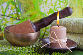 Singing bowl and a candle — Stock Photo