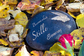 Grave stone in autumn — Stock Photo