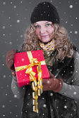 Woman in winter clothes with gift box — Stock Photo