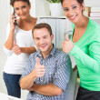 People showing thumbs up in office — Stok fotoğraf