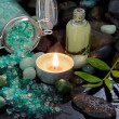 Spa arrangement - natural massage oil with a burning candle — Stock Photo #37839471