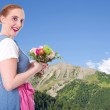 Bavarian girl with flowers — Stock Photo #37881587