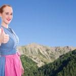 Bavarian girl with thumb up — Stock Photo