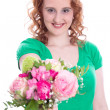 Woman with flowers on Mother's Day — Stock Photo
