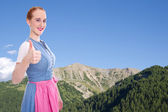 Bavarian girl with thumb up — Stock Photo