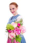 Young woman in bouquet — Stock Photo