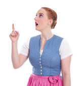 Bavarian woman pointing up — Stock Photo