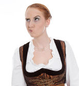 Skeptical woman in dirndl — Stock Photo