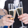 Carnival: young couple isolated on white drinking champagne — Stock Photo